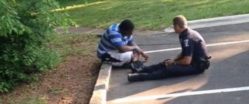 PHOTO: Officer Tim Purdy of the Charlotte-Mecklenburg Police Department soothes a potentially suicidal and autistic teenager in a photo that has gone viral.