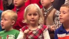 PHOTO: Claire Koch, 5, sings along with her classmates at her school's holiday concert.