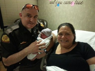 PHOTO: Utah woman Devi Ostler gave birth to a healthy baby boy on the side of the highway with the assistance of Trooper Carr.