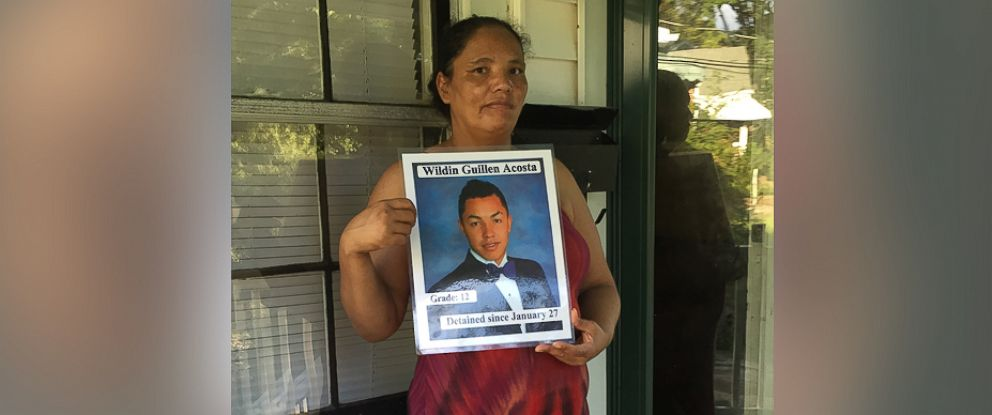 PHOTO: Dilsia Acosta holds a sign detailing her sons detention in a photo taken Aug. 11, 2016 at her home in Durham, North Carolina.