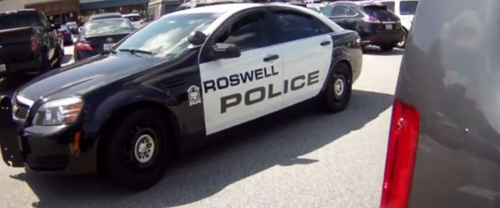 PHOTO: Police respond to a movie theater parking lot in Roswell, Georgia, where two dogs were rescued from a blazing hot vehicle.