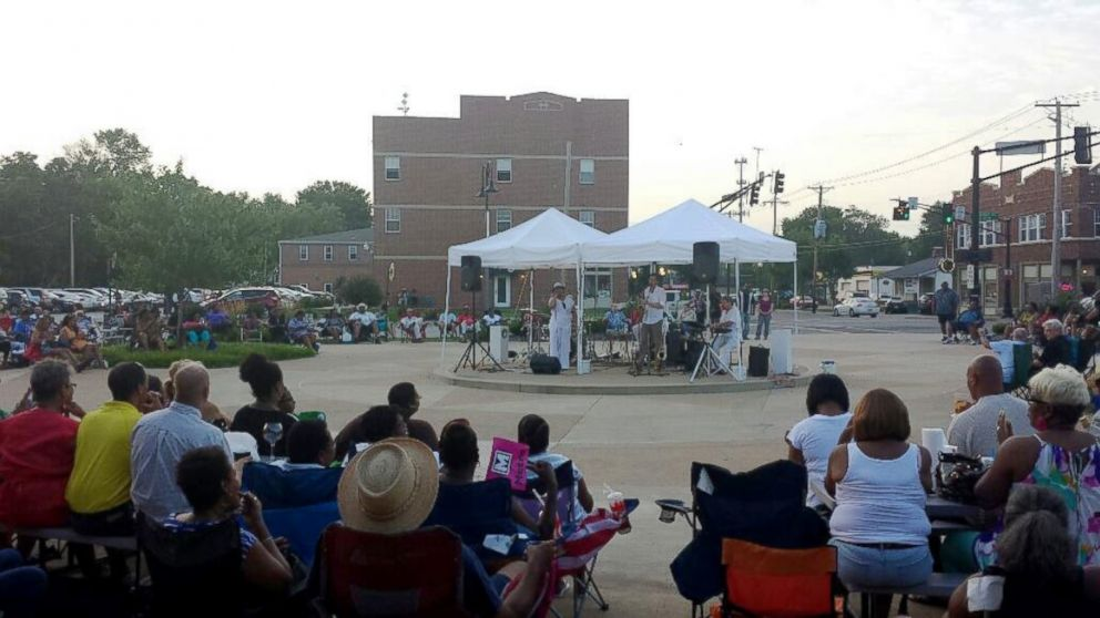 PHOTO: Residents listen to an evening concert hosted by the city of Ferguson, Mo., earlier this summer.