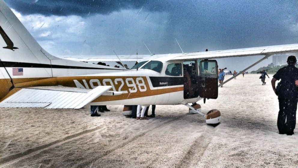 "PHOTO: Miami Beach Police tweeted this photo, July 29, 2014, with the text, ""#Plane makes emergency landing on beach right before storm.Pilot & 3 passengers safe. No injuries mechanical failure."""