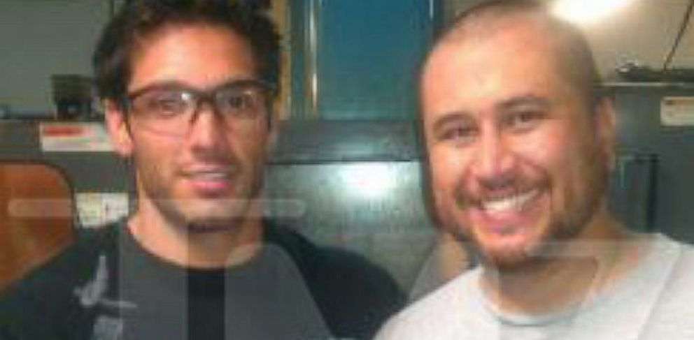 PHOTO: George Zimmerman and an employee pose for a photo taken inside the Kel-Tec