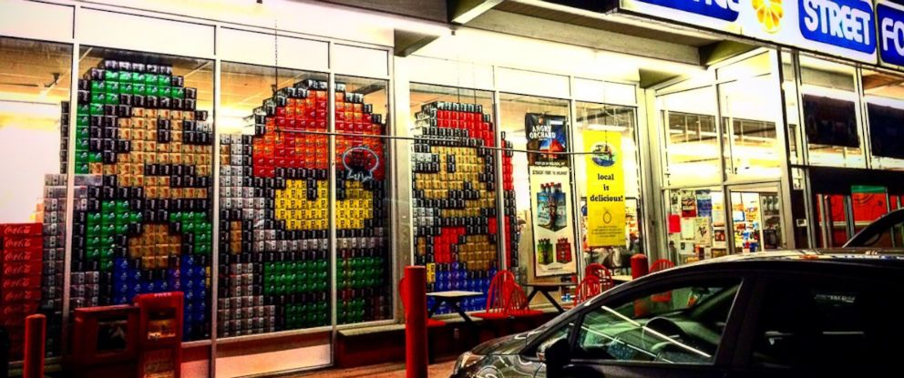 "PHOTO: A ""Super Mario Bros""-themed window display made from 12-pack boxes of soda is pictured here at Orange Street Food Farm in Missoula, Montana."
