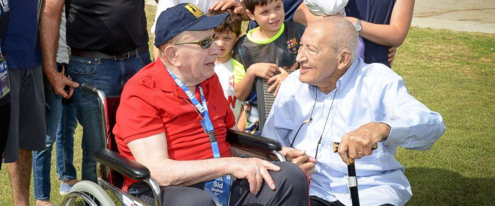 PHOTO: Sid Shafner, front left, and Holocaust survivor Marcel Levy, front right, whom Shafner liberated from Dachau, are seen reuniting for the first time in 21 years at an Israeli Air Force base in May.