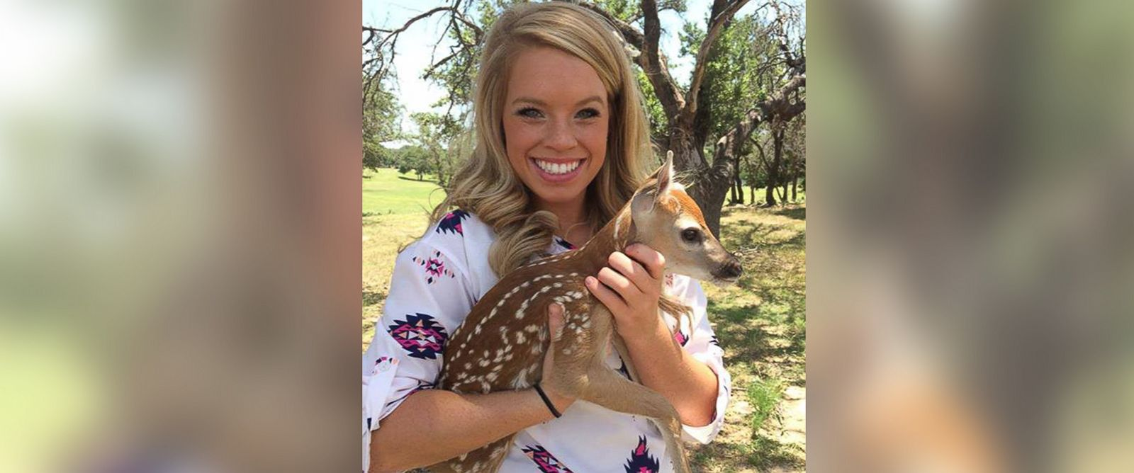 PHOTO: Kendall Jones poses with a photo of a dear on her ranch.
