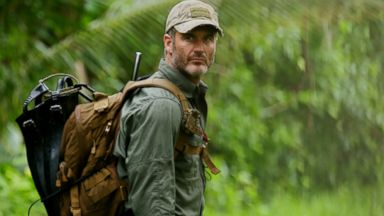 PHOTO: Joel Lambert trekking through the Panama forest.