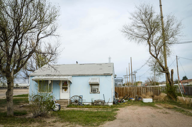 HT kansas life lakin blue house thg 131001 wblog Water, as Precious as Gold: Life in Parched Western Kansas
