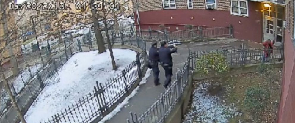 PHOTO: Surveillance video from December 2013 shows uniformed NYPD officers approaching then 15-year-old Keston Charles with their guns drawn as he holds his hands up outside his Brooklyn apartment building.