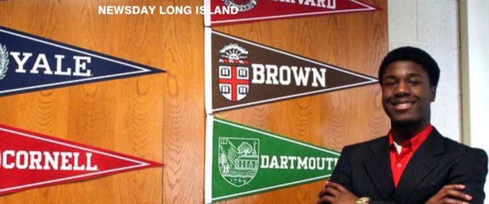 PHOTO: Long Island teenager Kwasi Enin poses in front of the pennants of Ivy League schools