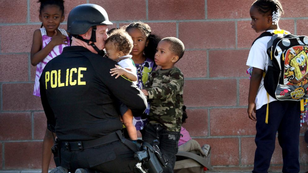 PHOTO  Inglewood police officer Joey Zeller kisses the head of toddler    Police Helping The Community