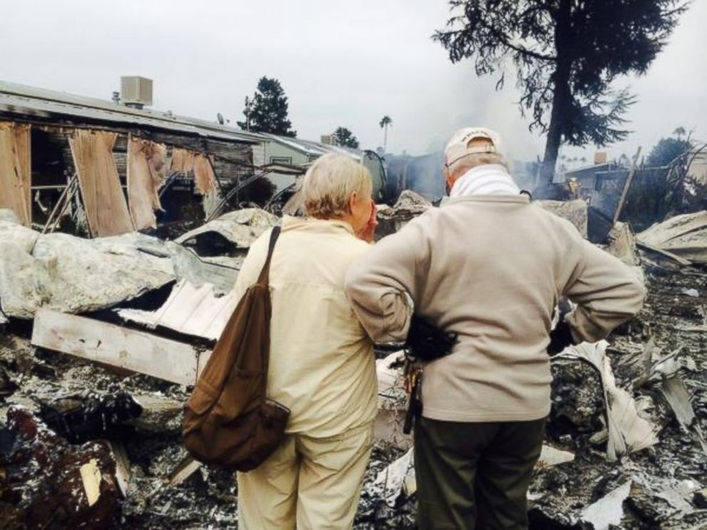 PHOTO: Laura Anthony posted this photo to Twitter with the caption Napa couple looks at the remains of mobile home they own with their son. One of 4 completely destroyed by fire. on Aug. 24, 2014.