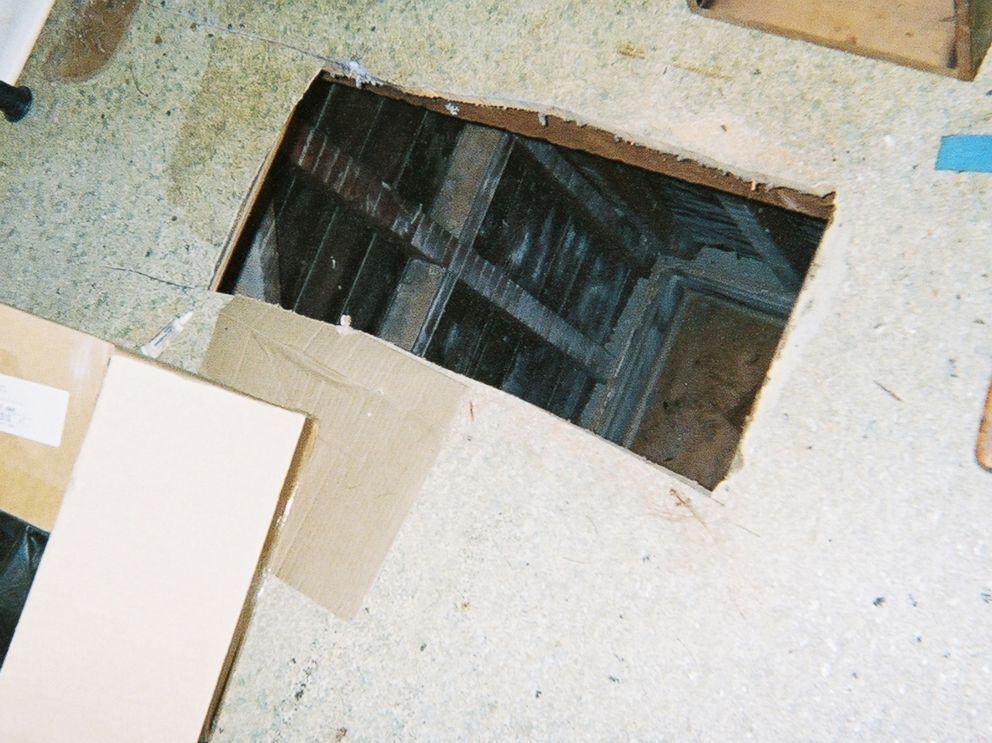 PHOTO: Kip and Nicole Macy cut this hole through the floor of their tenants apartment with a saw.