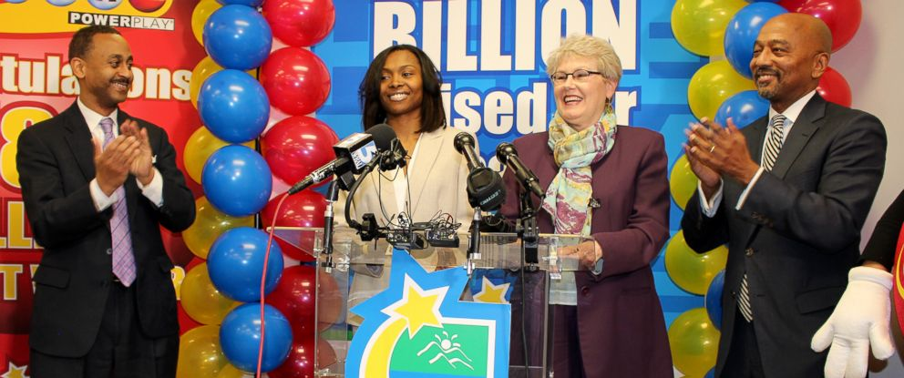 PHOTO: Marie Holmes accepts her $188 million dollar check for winning the North Carolina Powerball, Feb. 23, 2015.