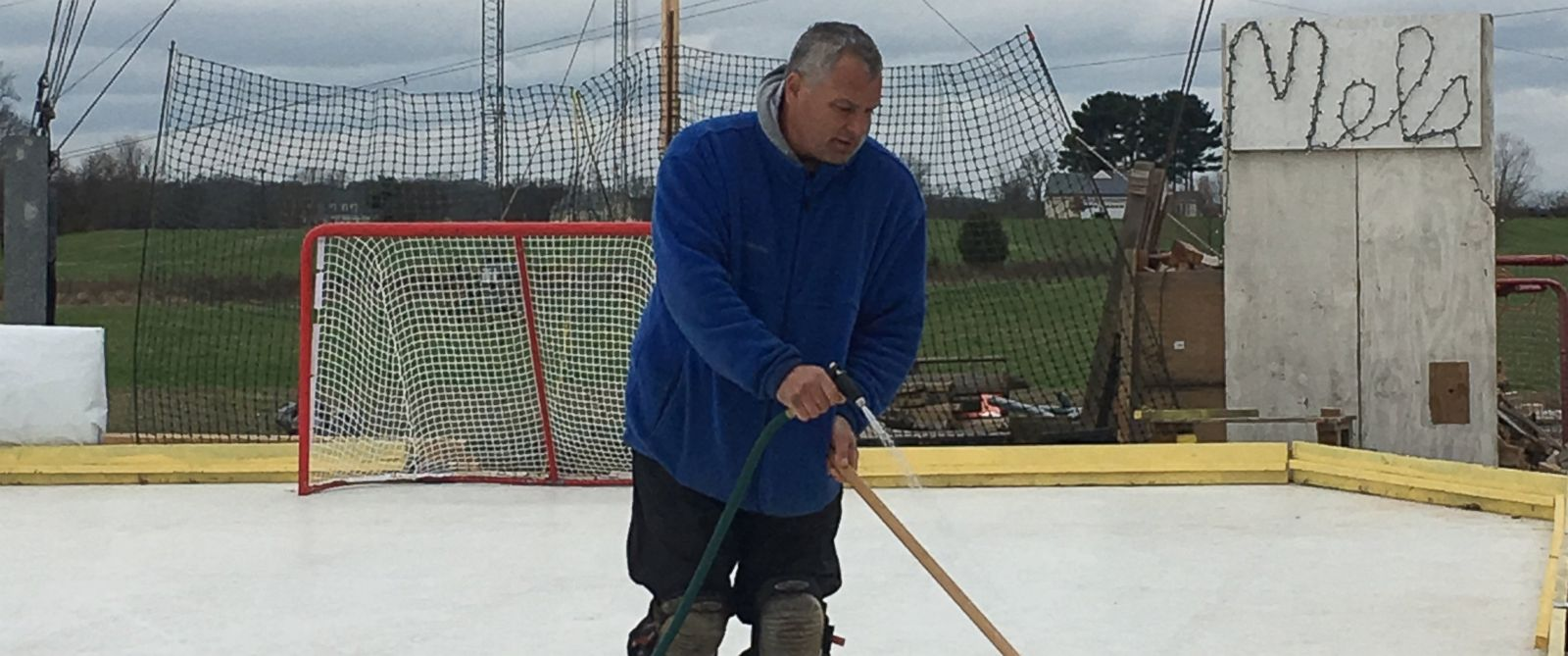 PHOTO:Maryland resident Marc Kohn maintains his hockey rink on January 1 2016 that he built in his backyard in memory of his stepdaughter Melanie Osborne.