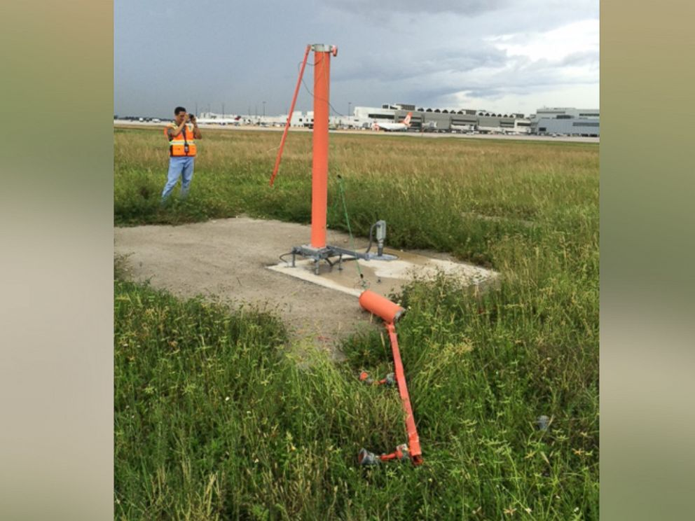 PHOTO: An agent discovered three downed poles at the end of Miami Airports Runway 9.