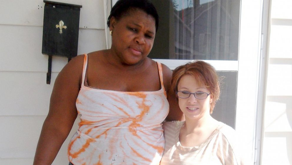 Michelle Knight posed for a picture with neighbor Altagracia Tejeda on