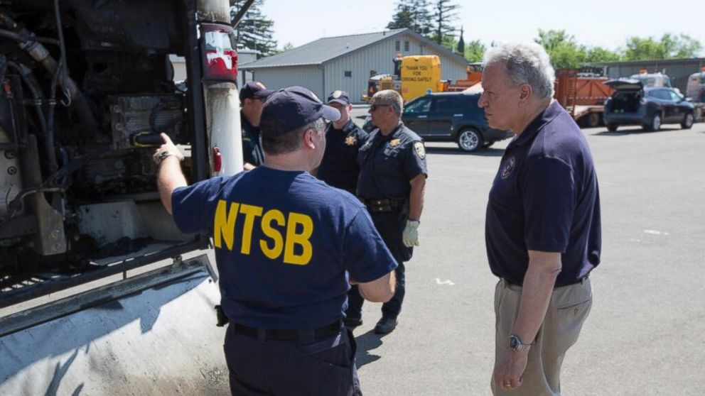 "PHOTO: @NTSB tweeted this photo on April 12, 2014, ""NTSB investigator identifies the Electronic Control Module (ECM) on bus involved in accident."""