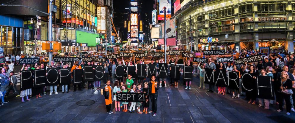 PHOTO: More than 30 people gathered in Times Square to promote the Peoples Climate March with illuminated signs on Aug. 28, 2014.
