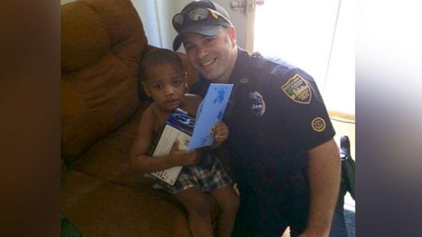 HT officer practico jef 140529 16x9 608 Kudos for Cop Who Buys Birthday Cake, Present, for Boy Whose Gift Was Stolen