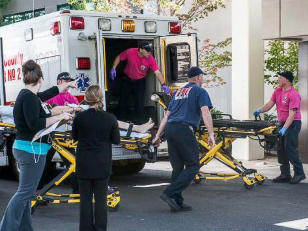 PHOTO: Paramedics tend to injuries after being called to an active shooter at Umpqua Community College in Roseburg, Oregon, Oct. 1, 2015.