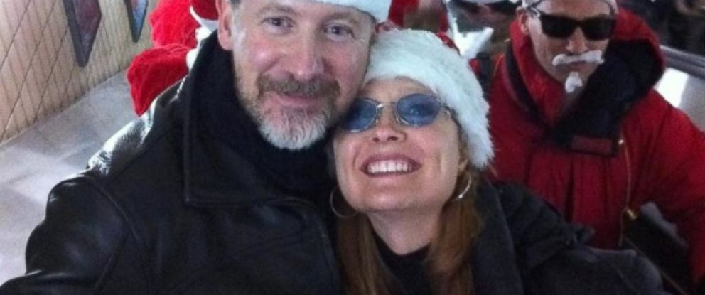 PHOTO: Philip Wood and girlfriend Sarah Bajc at Christmas. Wood, 50, is among the 239 people on board the missing Malaysia Airlines Flight 370.