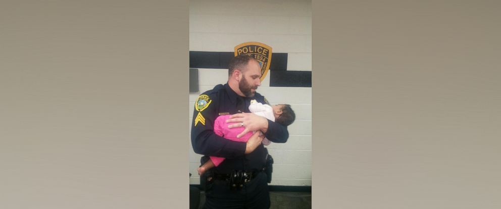 PHOTO: Sgt. Philip Bass is seen here cradling a 14-month-olg girl rescued from the bathroom of a grocery store in St. Albans, West Virginia, on Dec. 14, 2015.
