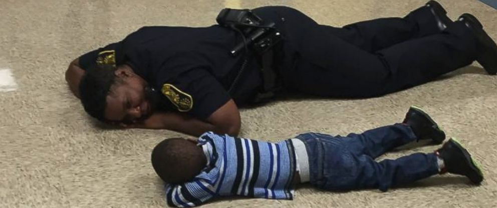 Delightful PHOTO: Indianapolis State Officer Precious Cornner Jones Lay On The Floor  Of A Public