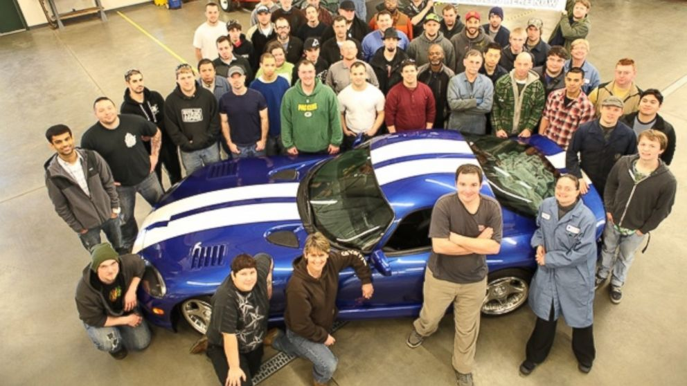 PHOTO: Students and faculty at South Puget Sound Community College surround their beloved 1992 Viper.