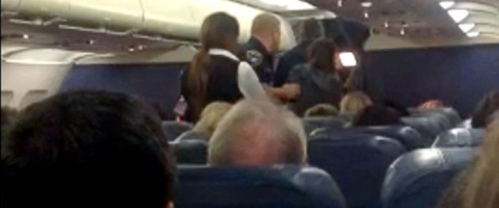 PHOTO: New video shows the moment an unruly flyer was escorted off of a Delta flight on Monday.