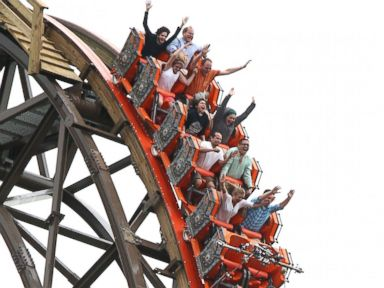PHOTO: Riders cheer as they experience a vertical drop from the top of Goliath, June 18, 2014.