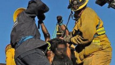 PHOTO: Firefighters rescue a woman who got stuck in a chimney in Thousand Oaks, Calif.