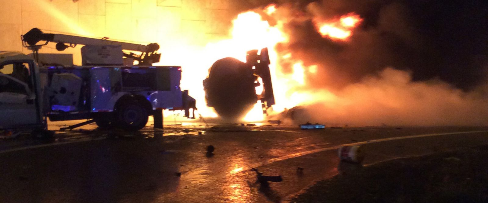 PHOTO: Flames are visible after a crash in St. Petersburg, Fla. involving a tanker truck, Jan. 6, 2014.