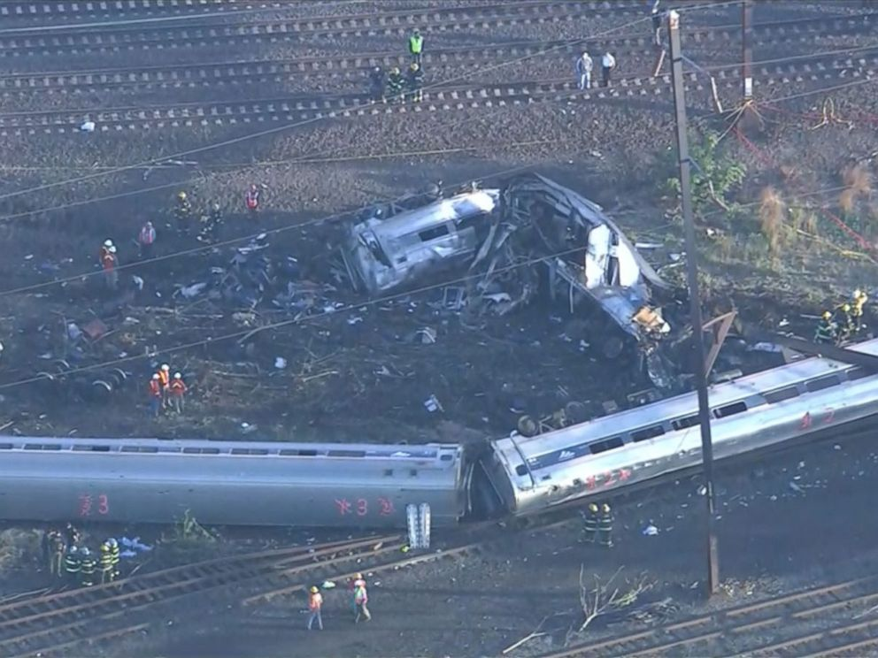 PHOTO: Emergency personnel work the scene of a deadly train wreck, May 13, 2015, in Philadelphia.