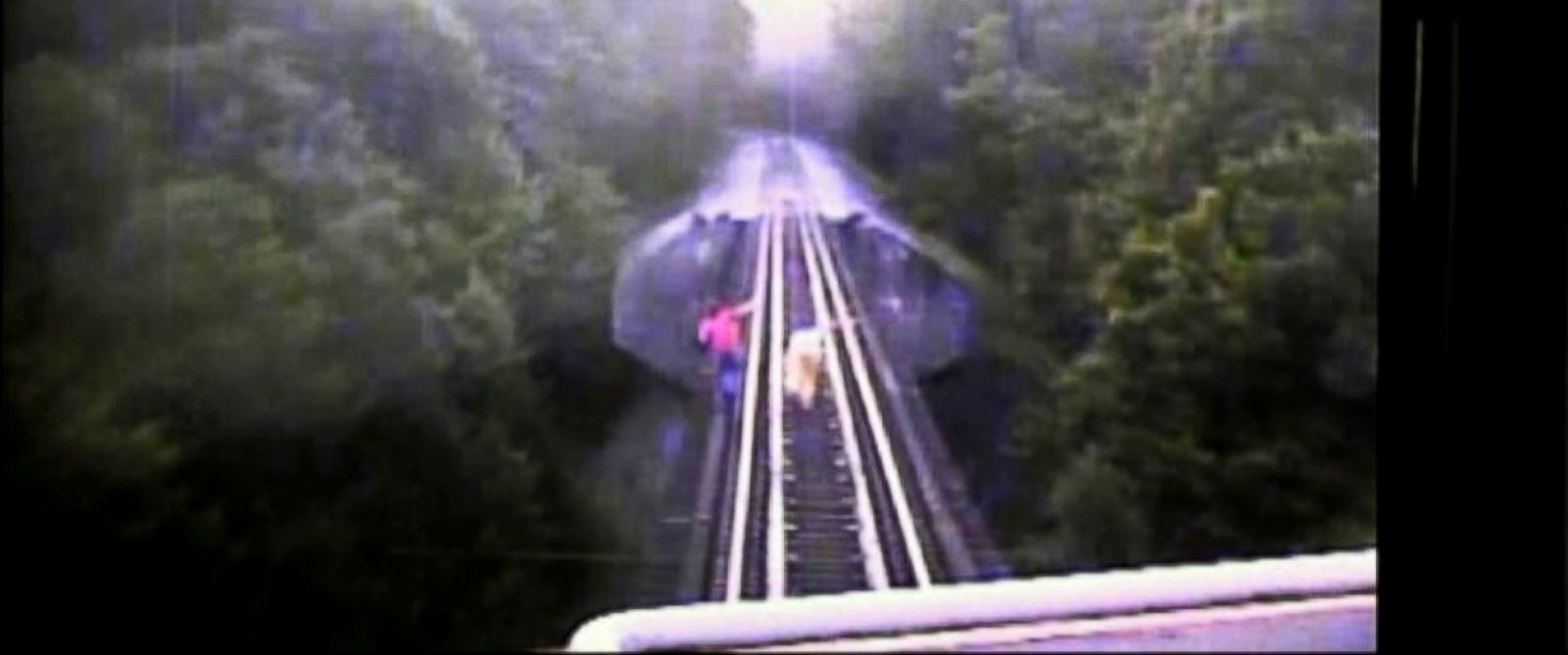 PHOTO: A camera mounted on the front of the train captures the moments when two girls duck under the train, letting it roll over them.