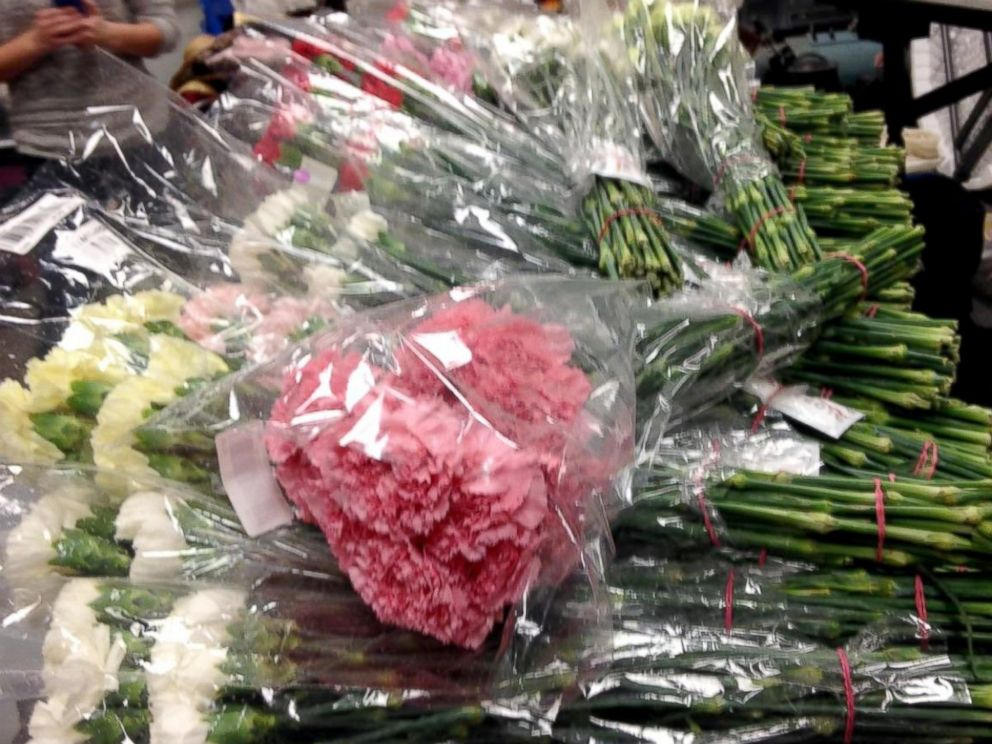 PHOTO: The high school senior bought carnations in more than six colors from an online wholesaler to hand out to every girl in school.