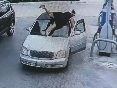 PHOTO: Surveillance video from a gas station in Dania Beach, Florida, caught the moment Janelle Della-Libera jumped on the car of a person who allegedly stole her purse.