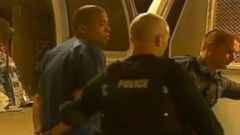 PHOTO: Kansas City police take a suspect into custody in connection with a series of highway shootings, April 17, 2014.