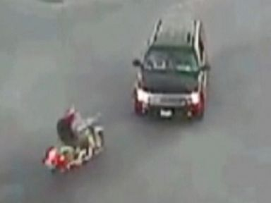 Shocking Video: Biker Walks Away From Crash