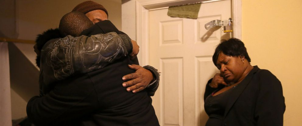 PHOTO: Melvin Jones, facing camera, hugs Robin Andrews, both brothers of Bettie Jones, 55, in Jones living room after she was shot and killed by Chicago police Dec. 26, 2015.