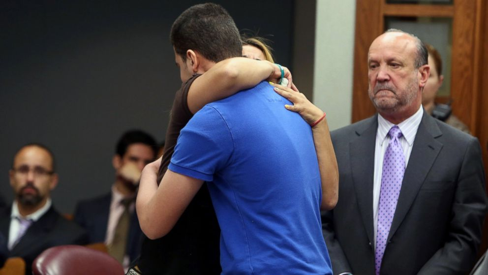 PHOTO: Ady Guzman-DeJesus, mother of the teen who was accidentally shot and killed on a school bus hugs the student, Jordyn Howe, who pulled the trigger after court deal, June 10, 2014.