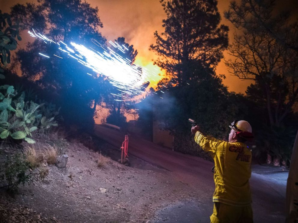 PHOTO: Cal Fire battalion chief and strike team leader Gino DeGraffenreid fires off flares to start a backburn to protect homes on Dec. 11, 2017 in Toro Canyon, Calif., at the Thomas Fire.