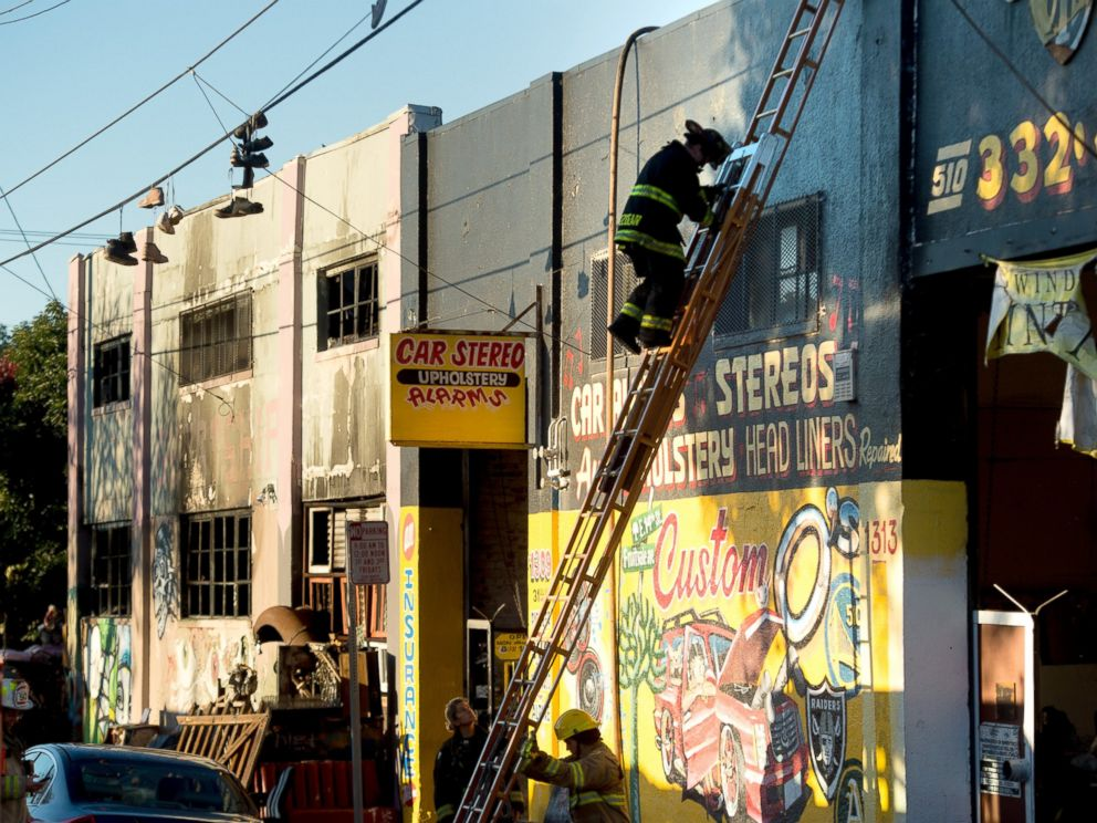 PHOTO: A firefighter climbs down a ladder at the scene of a fire that killed at least nine people on 31st St., Dec. 3, 2016, in Oakland, California.
