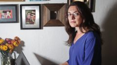 PHOTO: Cory Tschogl, 39, on one of her computers shes been using to deal with her Airbnb eviction situation, surrounded by photos of her Palm Springs home in her apartment in San Francisco.