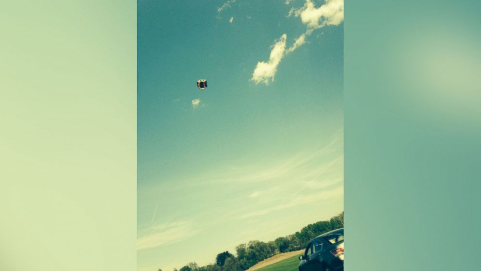 PHOTO: Two boys were thrown from an inflatable bounce house that became airborne in New York on May 12 when a strong gust of wind broke it loose from the stakes holding it down.