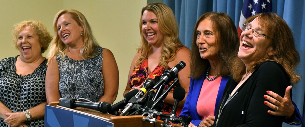PHOTO: Mavis Wanczyk, right, of Chicopee, Mass., laughs beside state treasurer Deb Goldberg during a news conference where she claimed the $758.7 million Powerball prize at Massachusetts State Lottery headquarters, Aug. 24, 2017, in Braintree, Mass.