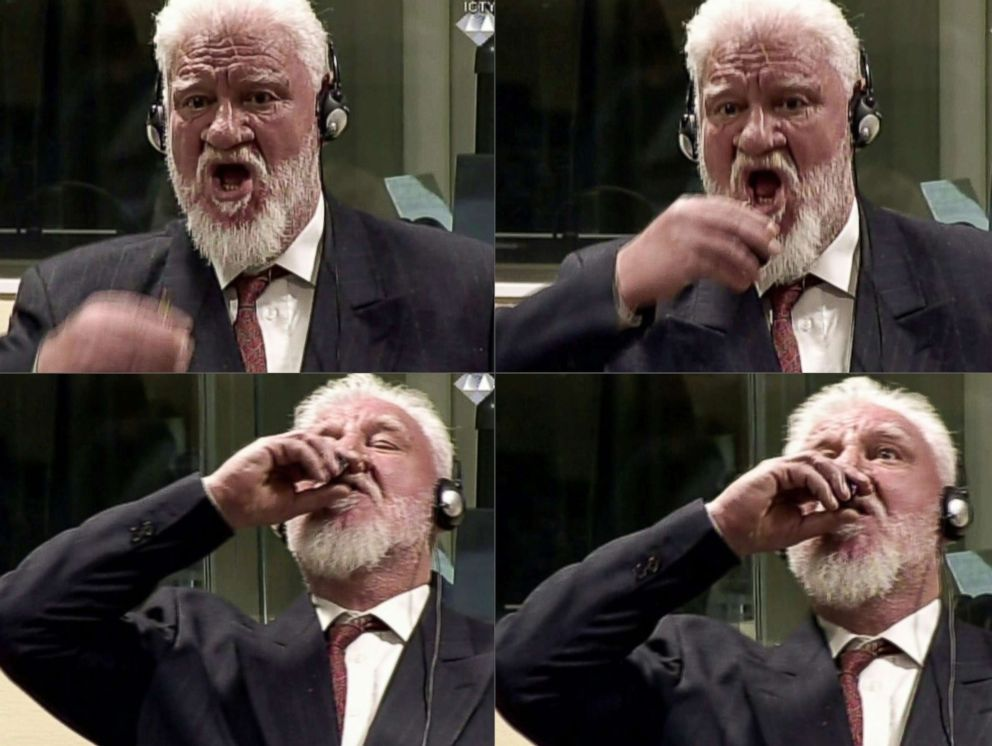 PHOTO: Former general Slobodan Praljak swallowing what is believed to be poison, during his judgement at the UN war crimes court to protest the upholding of a 20-year jail term, Nov. 29, 2017.