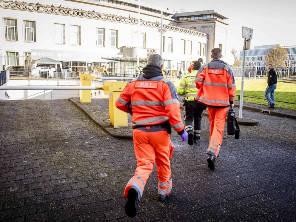 PHOTO: Emergency Services staff run near the International Criminal Tribunal for the former Yugoslavia (ICTY) in The Hague, Nov. 29, 2017, after Slobodan Praljak apparently drank poison upon hearing his 20-year sentence was upheld.