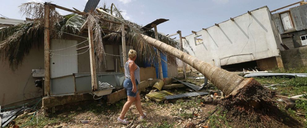 PHOTO: Nelida Trinidad walks around her destroyed home in Montebello, Puerto Rico, in the aftermath of Hurricane Maria, Sept. 26, 2017.